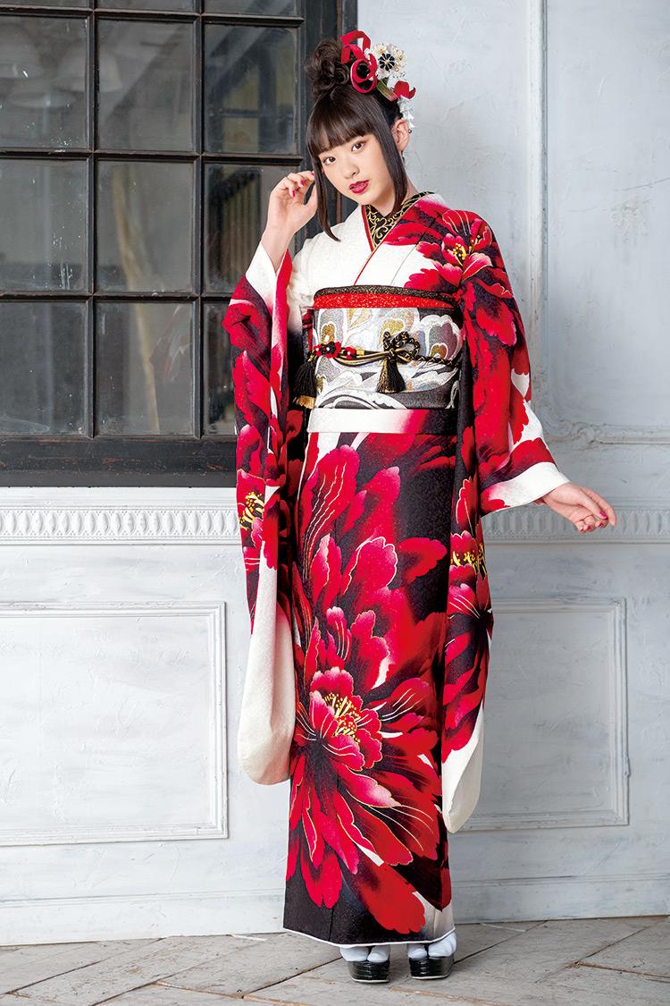 白地に赤い牡丹の花が大胆にデザインされたクールな振袖です。
